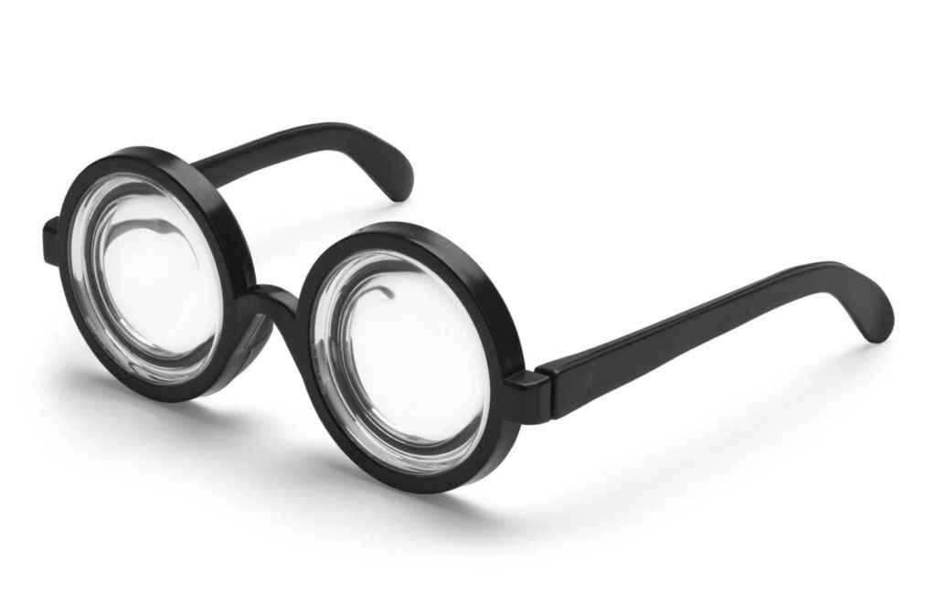 thick round bottle-bottom glasses in black frames on white background